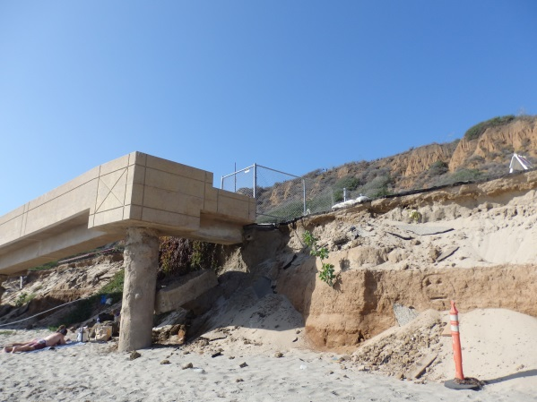 Fencing and signs where the bluffs and road to the ramp washed out