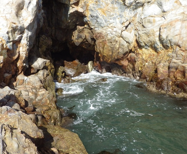 Sea Cave and Break between Tide Pools at High Tide
